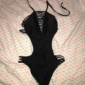 One piece black bathing suit with cutouts. Target